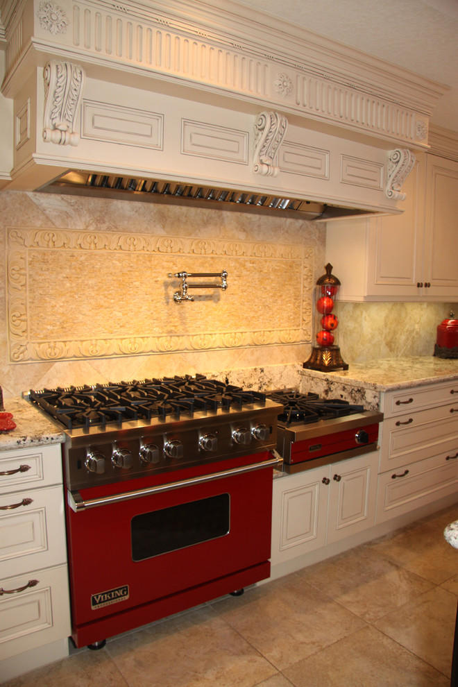 Traditional White Kitchen With Bright Red Appliances