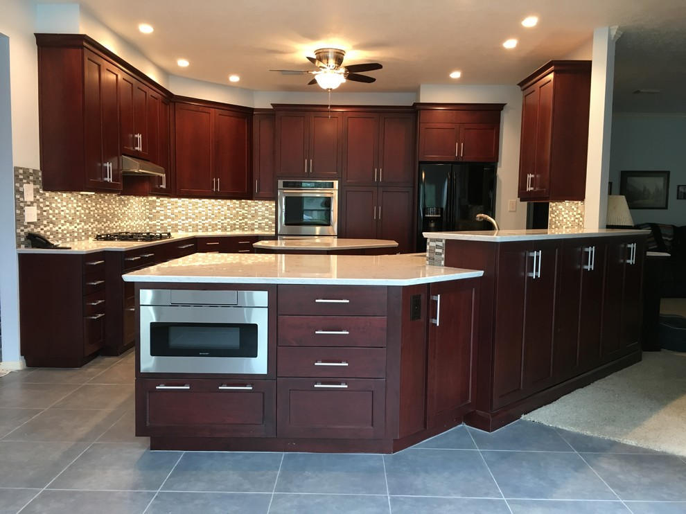 Bright kitchen with dark cabinets and white countertops ...