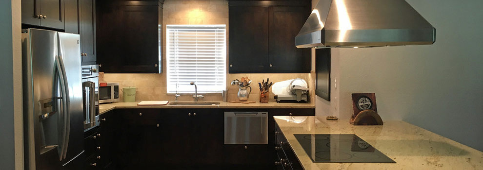 Proper Lighting And Light Granite Countertops Offset The Dark Dramatic Cabinets In This Kitchen Remodel Santa Fe Generous Highly Efficient Storage