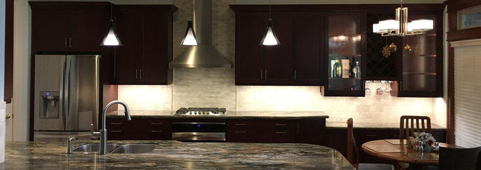 Open Concept Kitchen With Dark Cabinets And Quartzite